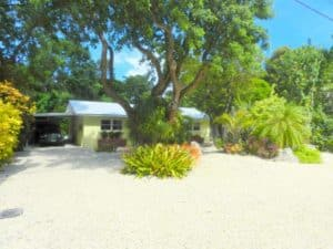 Exterior ground level Fl Keys yellow home.